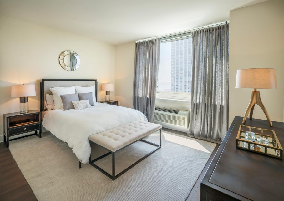 Elegantly furnished bedroom at The Morgan at Provost Square