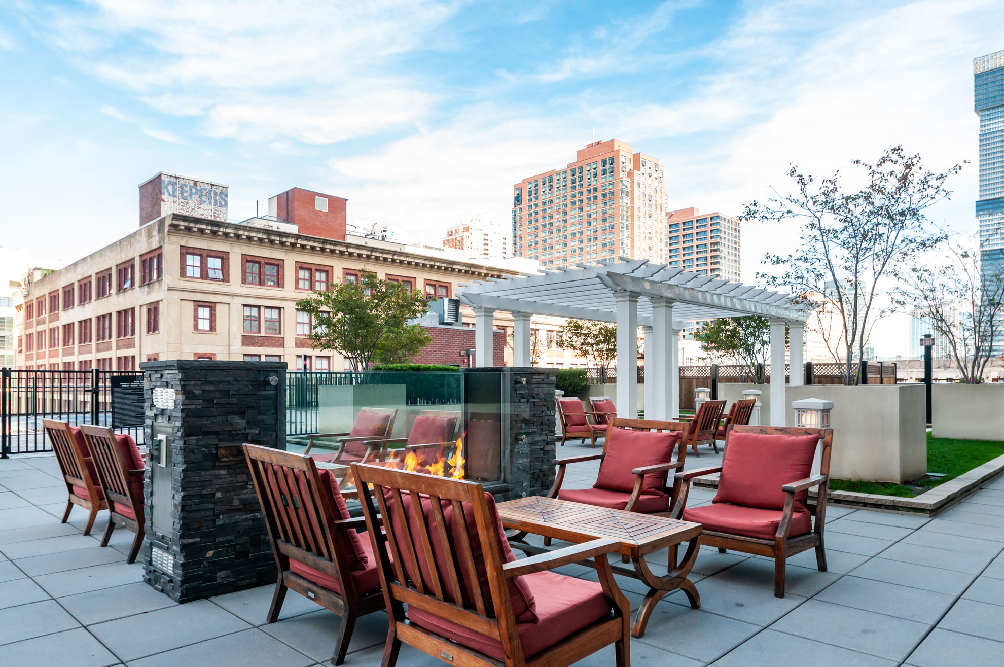 Exterior patio at The Morgan with fireplaces and conversation sets